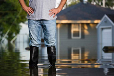 man-standing-in-flood-water